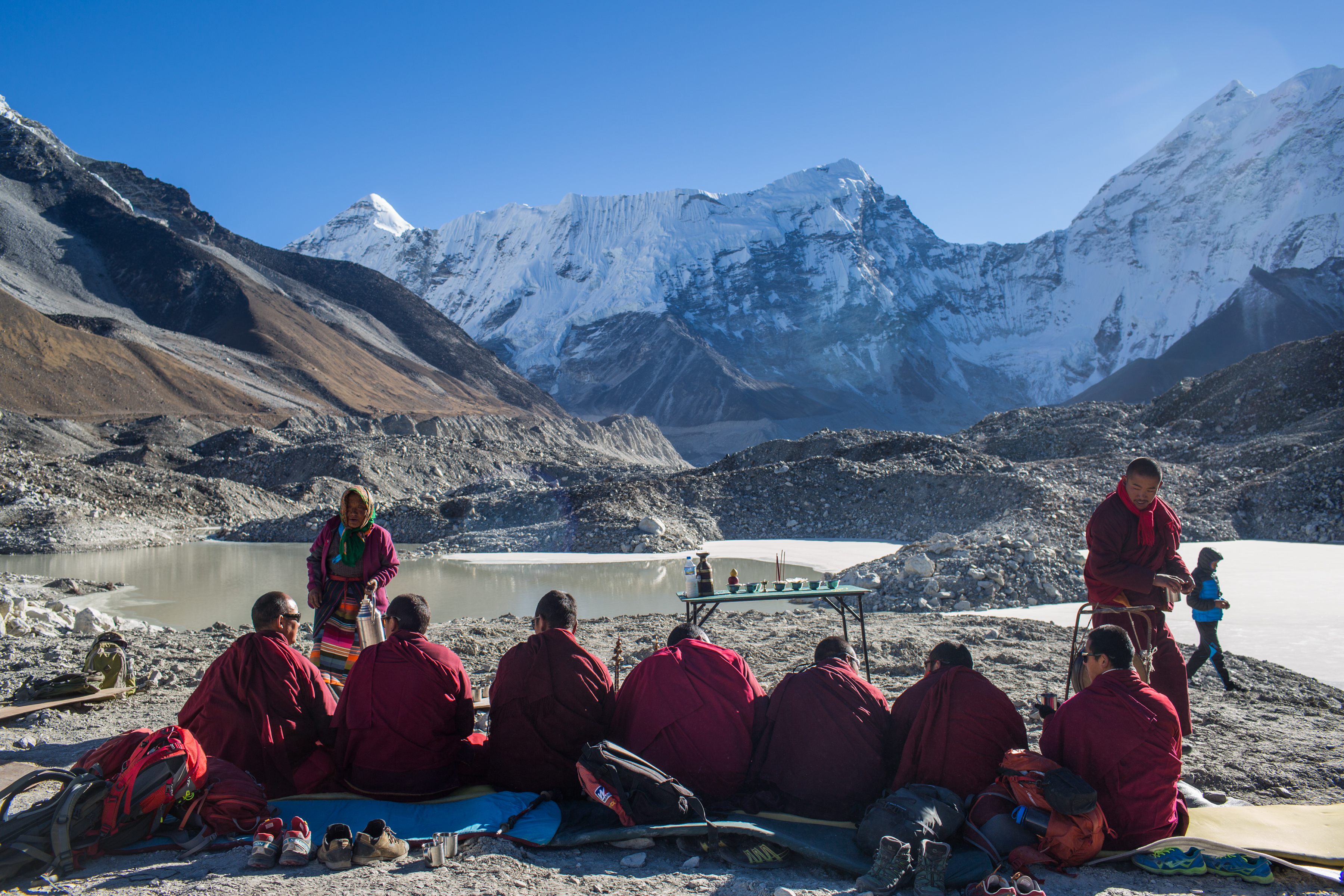 Buddhist monks perform a ceremony after a successful project to lower the level of the Imja Glacier Lake