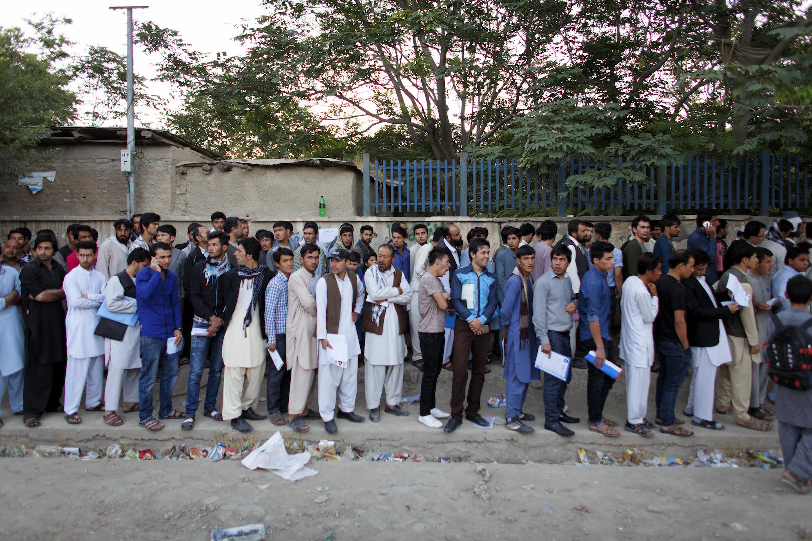 People lined up at the passport office in Kabul