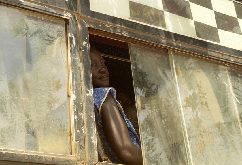 A South Sudanese refugee looks out of the window of a bus as it arrives at Imvepi settlement in northern Uganda.
