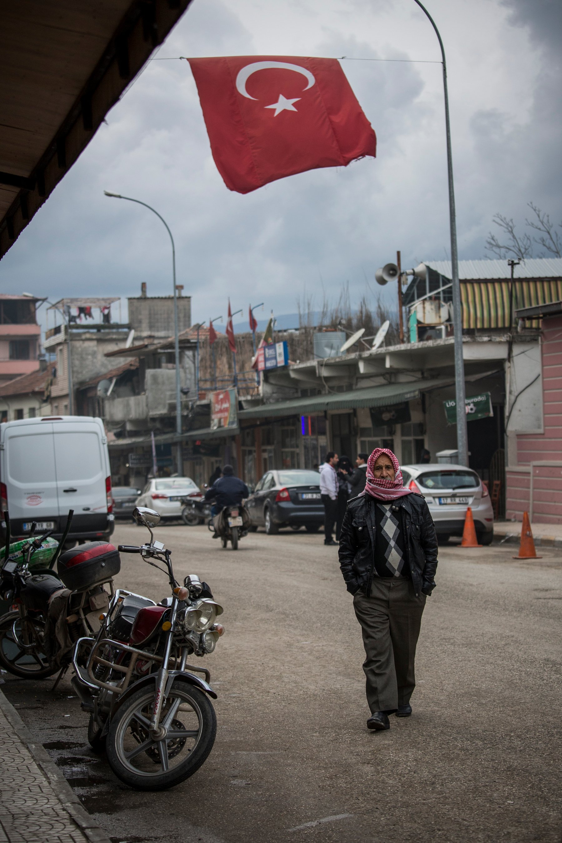 A Syrian man walks in a Turkish town