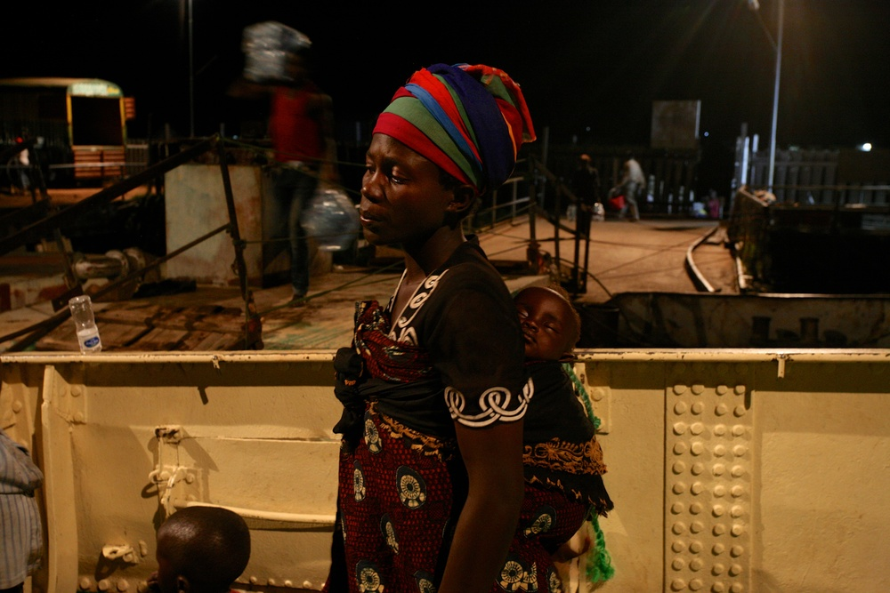 Delphin Nyiyanwi waits aboard the MV Liemba for the body of her 4-year old son to be carried off the boat after he died of suspected cholera.  ""