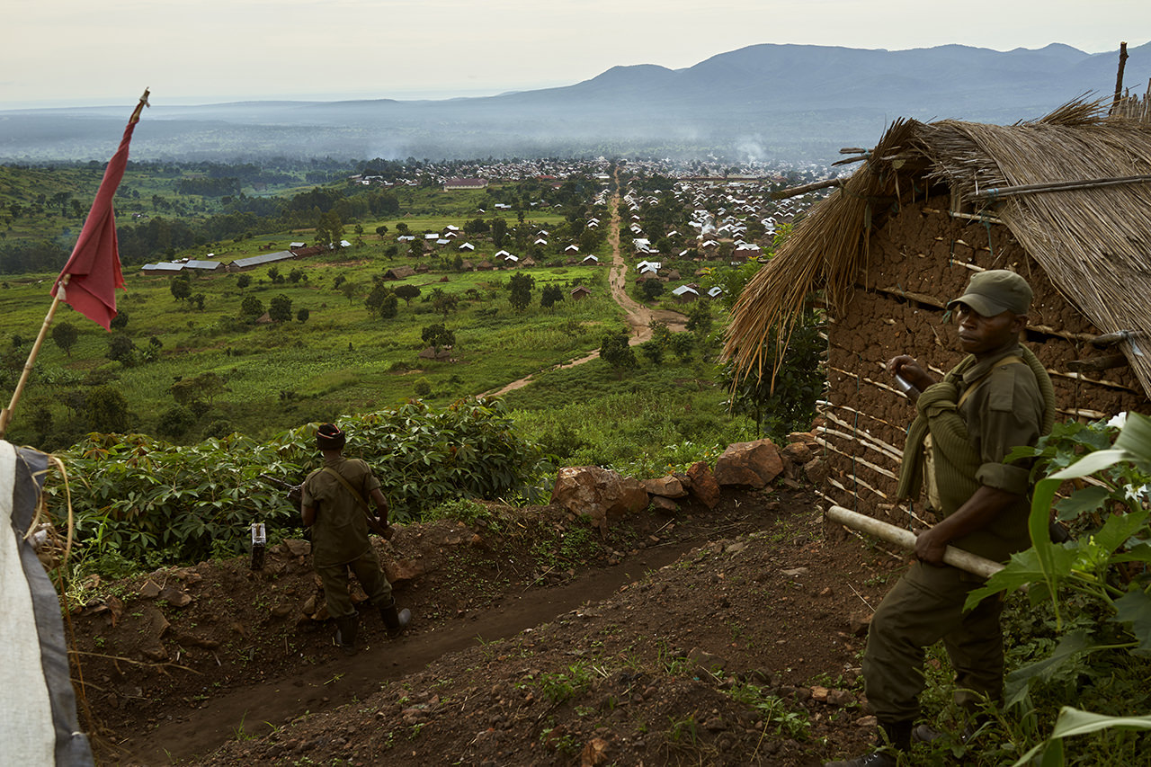 Two FARDC soldiers keep watch over an FARDC base overlooking the town of Kibirizi, North Kivu.