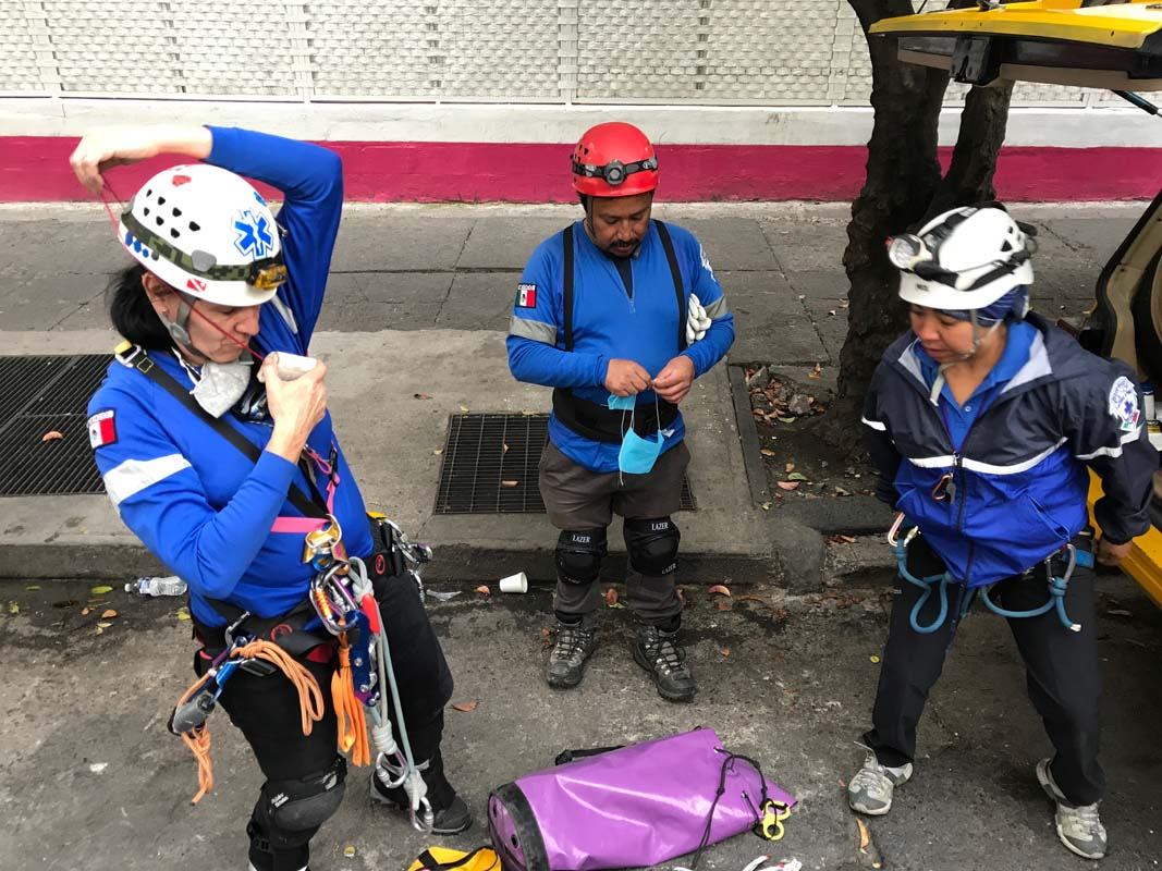 A group of rescue workers gets ready for their second shift at a five story office building in Mexico City.