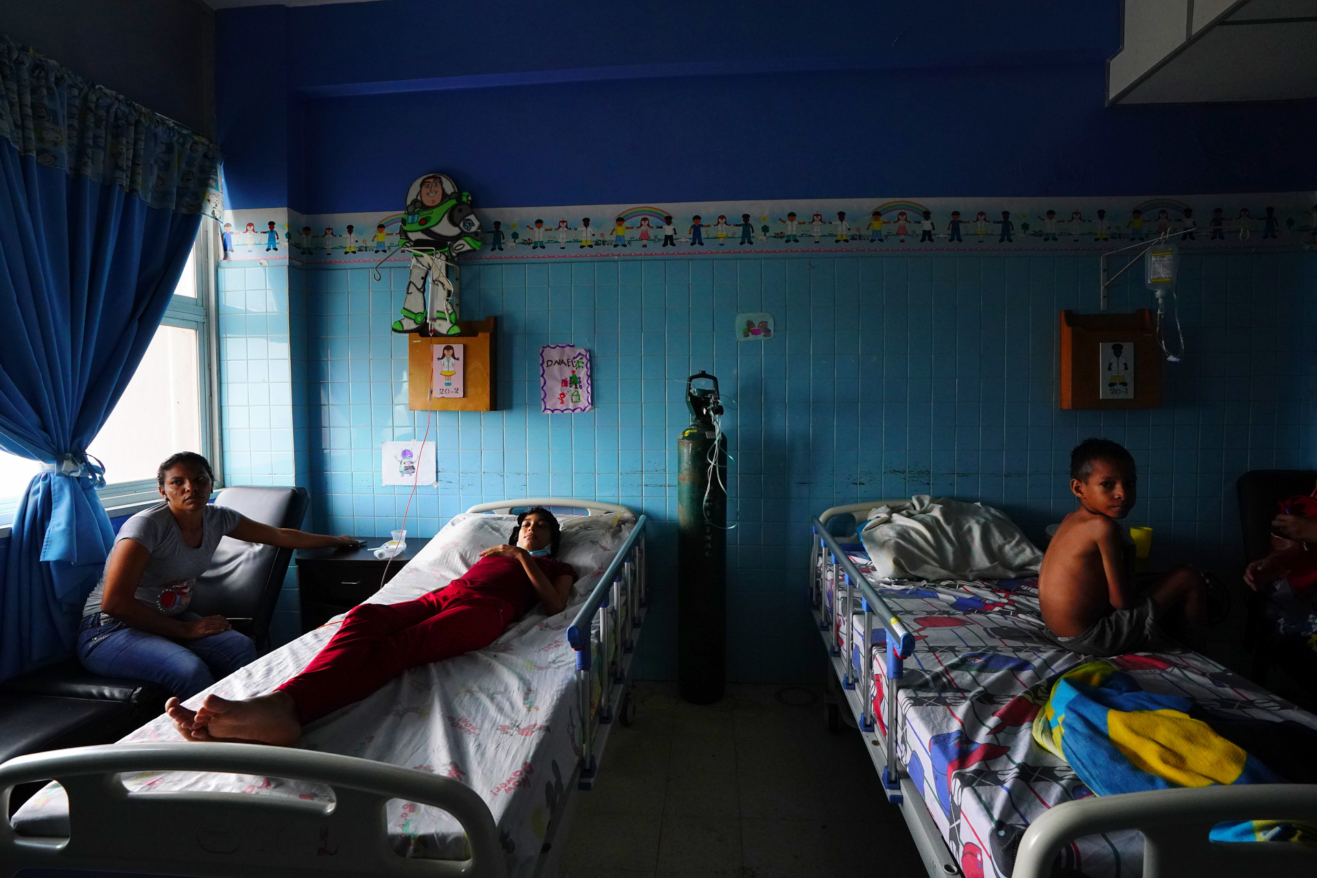 A blue room with hospital beds and decorations for children