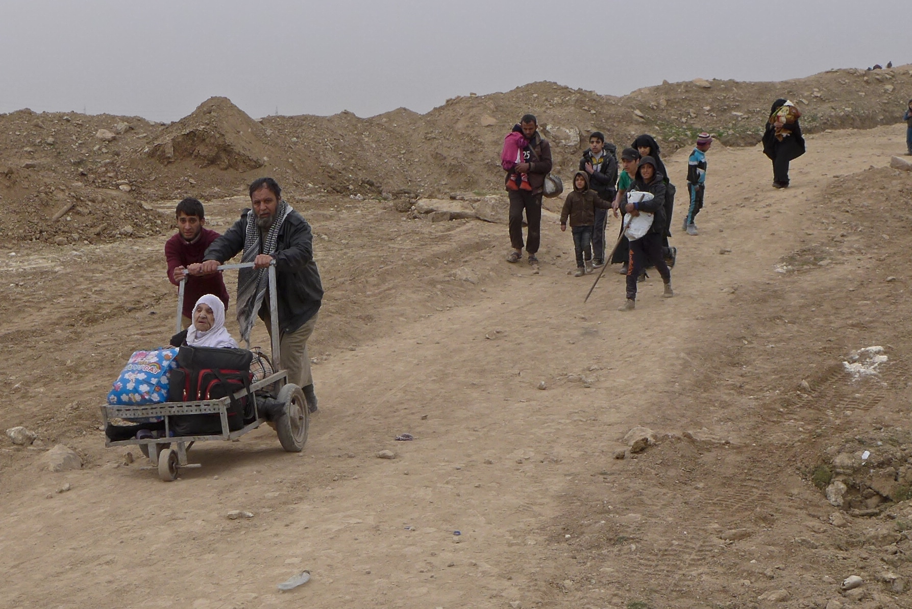 Barefoot flight from Mosul: The long road to safety