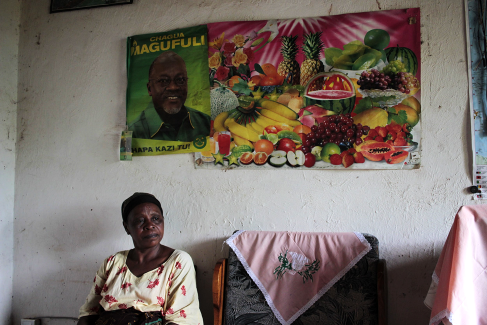 Posters of Magufuli and the ruling CCM regime adorn Magreth Mtema's living room