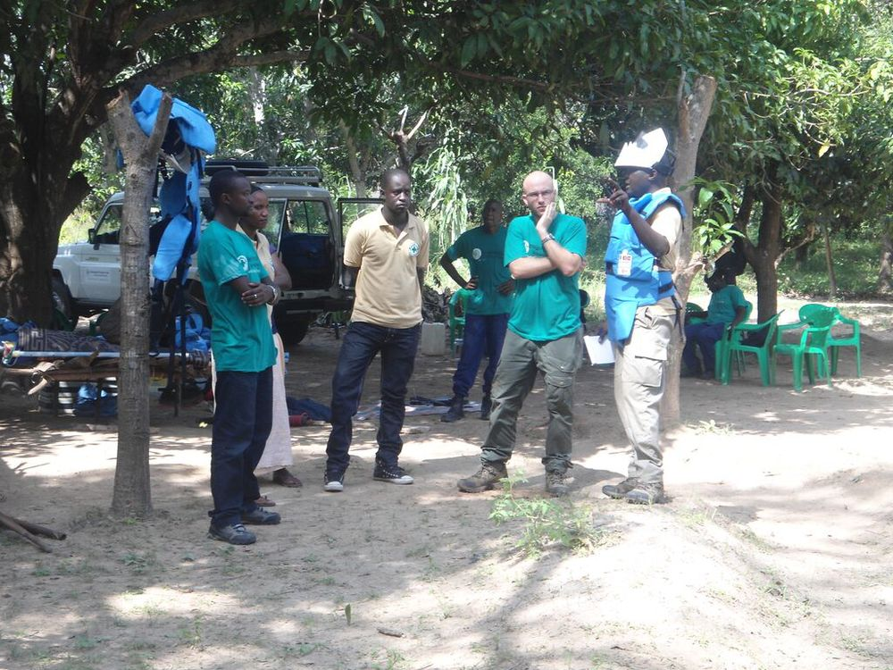 NPA personnel discussing a demining exercise in late 2013