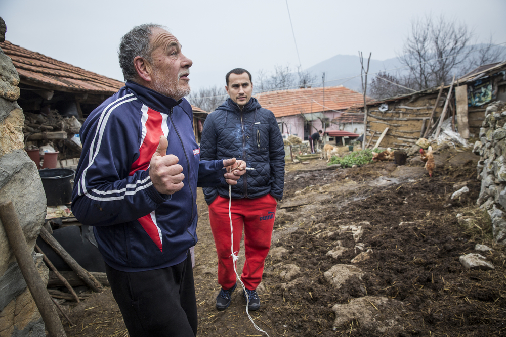 Aleksander Nackov and his father, Ljubomir, at their farmhouse in Gradina, close to the Bulgarian border where the older man says he often sees migrants passing near his home