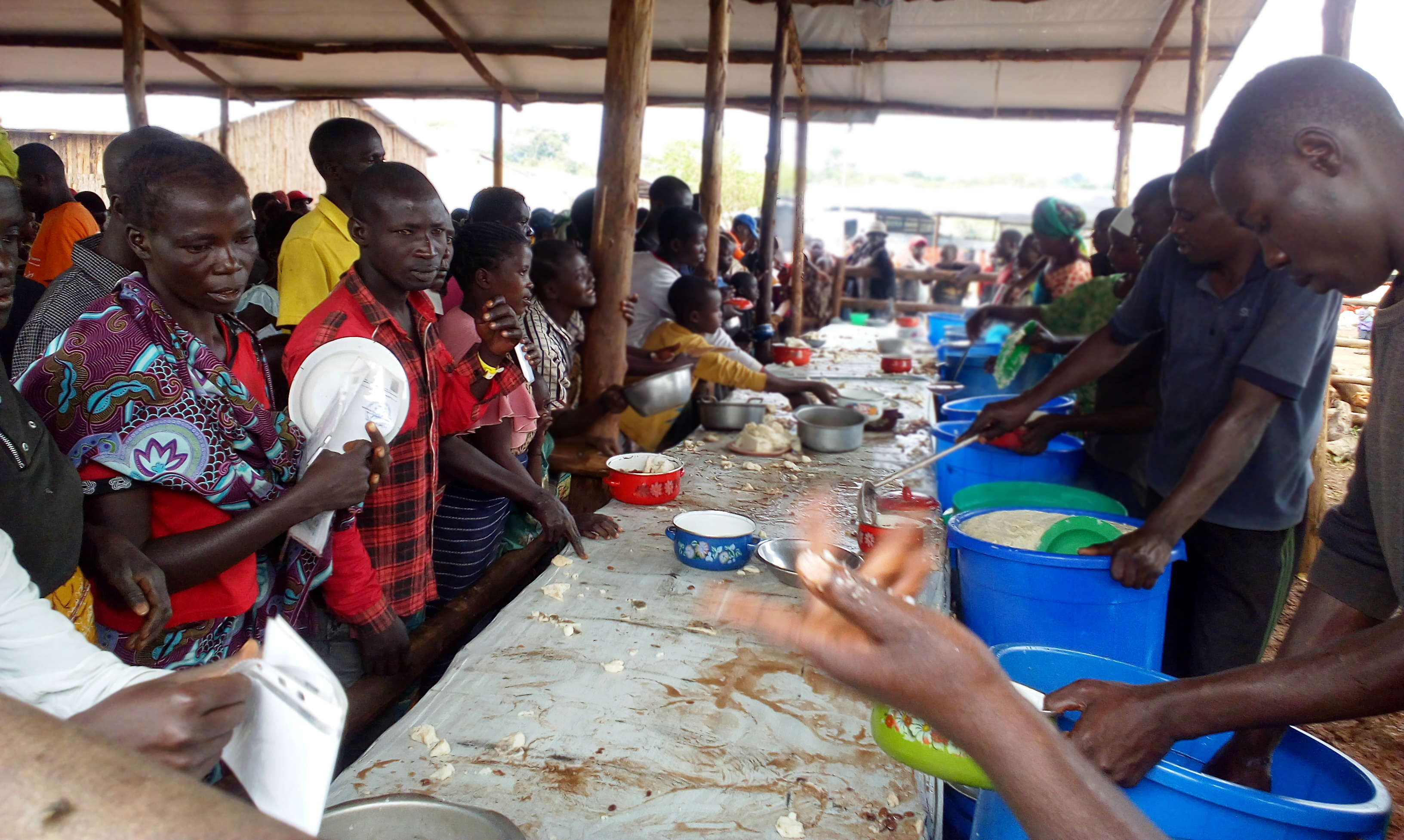 Refugees from Ituri Province get lunch at Kagoma Reception Centre, Kyangwali refuge