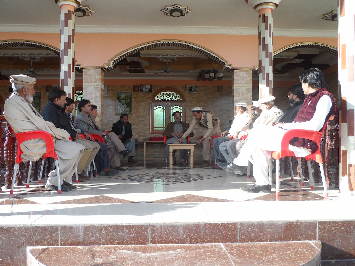 Malik Anwar Zeb, a tribal elder in Pashat village in Bajaur Agency, holds a meeting to discuss the Pakistan government's proposed reforms for the FATA region