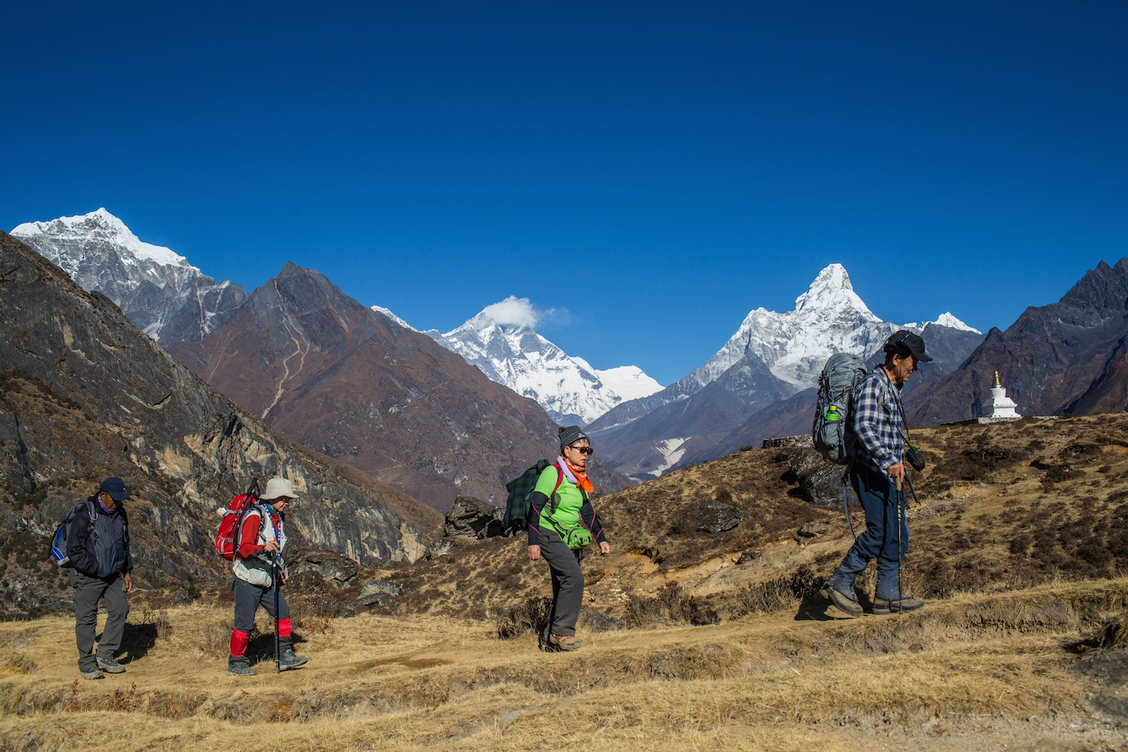 Tourists trek through Solukhumbu District in the Everest region