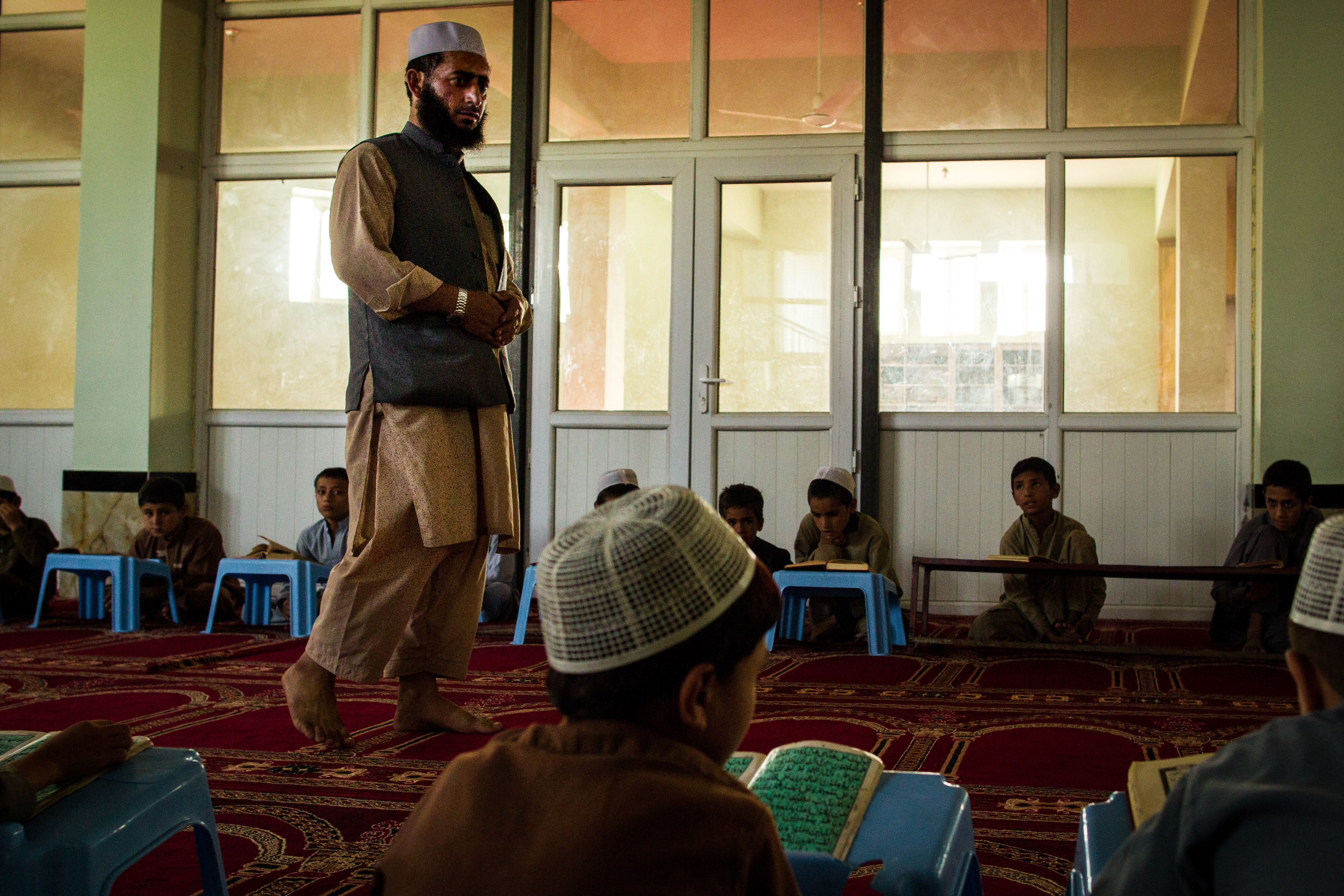A man teaches children at a mosque in Kabul.