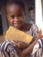 [Guinea-Bissau] Girl shows her vaccination certificate.