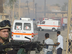 [Iraq] Red Crescent ambulances treat the injured following the fatal bombing at the ICRC building in Baghdad.
