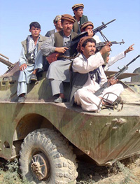 Armed men on top of an armoured vehicle, Kabul, Afghanistan, 10 December 2003. The rule of gun is stronger as the first months after the Taliban collapse.
