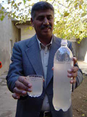 [Iraq] The head of Khanaqin's water department with a sample of treated water.