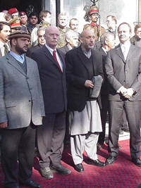 [Afghanistan] Afghan defence minister Marshal Fahim, German Defence Minister Peter Struch, Afghan President Hamed Karzi and The Netherlands Defence Minister (Name not available) at the ISAF handover ceremony in Kabul.