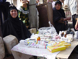 [Iraq] Woman sells stolen medicines in Basrah market.