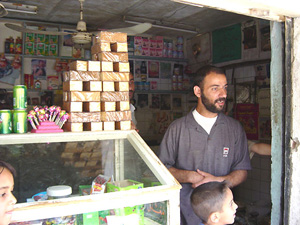 [Iraq] Ali Hasan, a food agent, uses his shop as a distribution point.