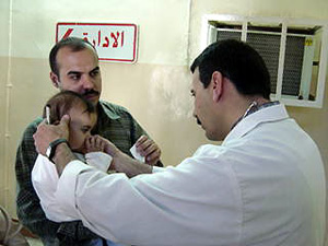 [Iraq] Doctor checking sick child, Baghdad.