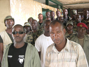 "[Cote d'Ivoire] Zuegen Toure (left), the leader of the GPP pro-Gbagbo militia group in Cote d'Ivoire, with Moise Kore (right), his ""Defence Minister,"" and a group of GPP volunteers at their training centre in a commandeered primary school in Abidjan in Oc"