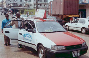[Gabon] One of 300 taxis that have been drafted into the fight against HIV/AIDS in the Gabonese capital Libreville. Free condoms and information leaflets will be available inside the cabs from December 2004 to the end of February 2005.