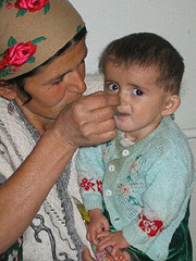 [Tajikistan] A young Tajik child is treated for severe acute malnutrition at an AAH Therapeutic Feeding Center.