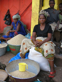 [Guinea] An unhappy woman selling rice in Conakry. Food prices have increased six-fold in recent years while wages have stagnated.