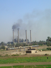 [Iraq] The Baghdad power plant spews black smoke into the air, even after repairs this spring that were supposed to make it run more cleanly.