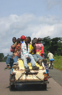 [Guinea] Transportation is rare in Guinea and taxi brousse cars are stuffed with travellers, June 2004.