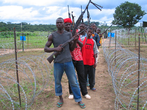 [Liberia] Fighters loyal to former Liberian president Charles Taylor line up to surrender their weapons to UN peacekeepers at a disarmament camp in Ganta, Nimba county, September 2004.