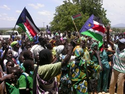 [Sudan] A crowd dancing outside the parliament building in Juba, southern Sudan.[Date picture taken: 2005/09/28]
