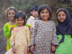 [Pakistan] These girls outside a tented camp in Muzaffarabad, capital of Pakistan-adminstered Kashmir, joined the ranks of over 3 million people rendered homeless in 8 October quake. [Date picture taken: 10/31/2005]