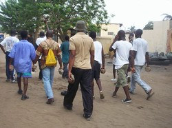 [Togo] Armed only with stones for the time being, but some youths want guns. Togo youths protesting at Gnassingbe's seizure of power, February 2005.