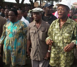 [Togo] Togo's opposition leaders march against Faure Gnassingbe. February 2005. From left to right: Yawowi Agboyibor of CAR, Emmanuel Bob-Akitani of UFC and Leopold Gnininvi of CDPA.