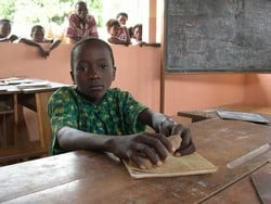 [Benin] Ten-year-old Bonaventure Fon worked for two long years on a manioc farm in Nigeria. He begged his parents for permission to leave Benin after his oldest brother returned from a stint working abroad with a brand new radio. February 2005.