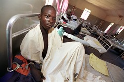 An injured Lord's Resistance Army fighter, captured in battle by the Uganda People's Defence Forces and taken to Kitgum Hospital, Uganda, for treatment, 24 March 2005.
