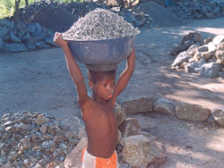 [Benin] Child working at a quarry in Benin where stone is crushed into gravel, June 2005.