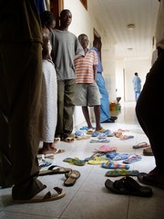[Senegal] Migrants from Cote d'Ivoire in Senegal in the hallways that become bedrooms at night.