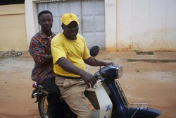 [Togo] With caps and tee-shirts, the moto-taxi drivers 'messengers of hope' sensitize people on HIV/AIDS in the capital city Lome.