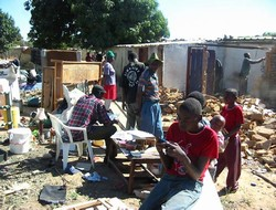 [Zimbabwe] Household goods are thrown out as a family complies with instructions