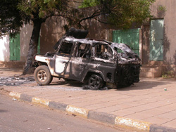 [Sudan] A car damaged during the 1 August 2005 riots in Khartoum over John Garang's death.