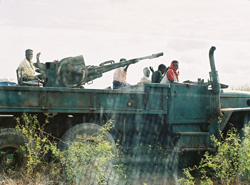 [Somalia] Armed Somali militiamen, locally called 'technicals', driving around the town of Jowhar on 1 August 2005.