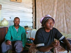 [South Africa] George and Elizabeth Madisha at their newly constructed shack at a squatter camp near Johannesburg. They fled their homestead in December 2004 after allegedly being threatened and harassed by their landlord, who wanted them off his land. [D