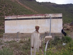 [Yemen] Al-Haima resident, Abdulaziz Ahmad Ali, contemplates the problems of water supply that affect his village.  The common well is the focus of competing demands for water between the local area and the nearby city of Taiz. [Date picture taken: 01/17/