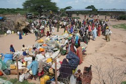 [Kenya] Refugees wait with their belongings to be collected for their transfer to Dadaab's camps, Liboi reception centre, along the Kenya-Somalia border in the remote eastern region of the country, 28 November 2006. The United Nations High Commissioner