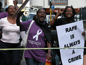 [South Africa] Women's rights activists protest against rape outside the Johannesburg High Court. [Date picture taken: 02/13/2006]