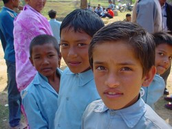 [Nepal] Three young school boys outside a school in rural Nepal. Education has been badly affected by the decade-long Maoist insurgency. [Date picture taken: 03/16/2006]