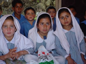 [Pakistan] Lucky girls like these are able to continue to go to school, despite the earthquake. [Date picture taken: 04/dd/2006]