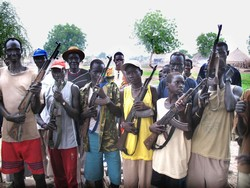 [Sudan] Boys and men from the White Army civilian defence force carrying arms in Akobo, Jonglei State, South Sudan, July 2006. Some members of the White Army have resisted disarmament for fear of increased vulnerability to attack. Others do not accept the